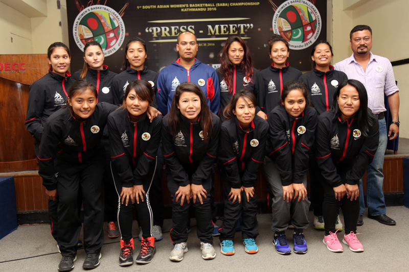 Nepali national women's basketball team members pose for a group photo in Kathmandu on Friday, March 25, 2016. Photo: RSS