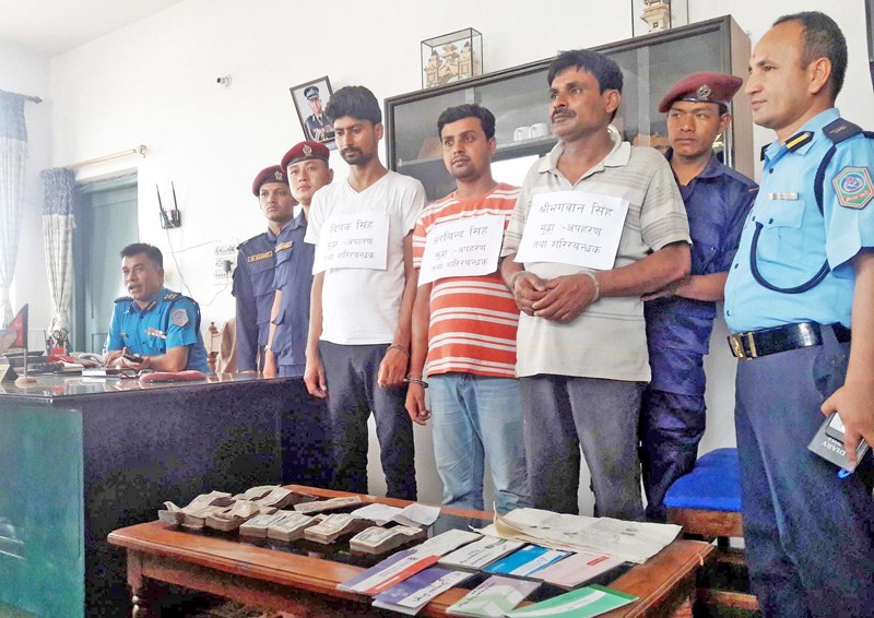 Police making public three persons including a constable involved in abduction and extortion of a business man, along with the confiscated items, in Birgunj on Sunday, March 27, 2016. Photo: Ram Sarraf
