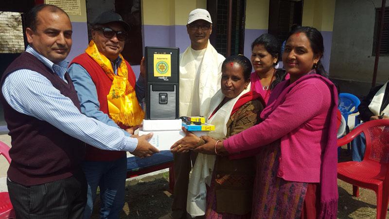 Geeta Khanal (2nd from right, front), principal of the local Janaki Lower Secondary School in Nayapati of Kathmandu, receives a computer from the Rotary Club of Rajdhani, on Saturday, March 12, 2016. Photo: Guna Raj Pyakurel
