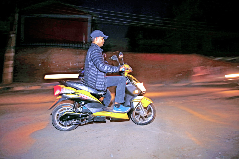 A man riding an e-scooty without wearing a helmet, in Anamnagar, Kathmandu, on Wednesday, March 9, 2016. Photo: THT