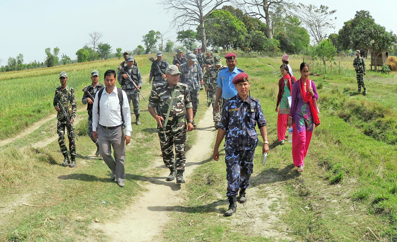 A joint security team from Nepal and India patrolling the no man's land in Balauri  Municipality of Kanchanpur district on Tuesday, March 22, 2016. Photo: RSS
