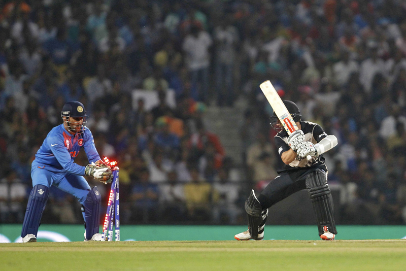 India's captain and wicketkeeper Mahendra Singh Dhoni (L) stumps New Zealand's captain Kane Williamson, at Nagpur on Tuesday, March 15, 2016. Photo: Reuters