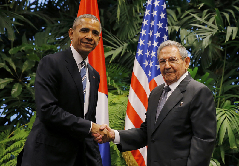 US President Barack Obama and Cuba's President Raul Castro shake hands during their first meeting on the second day of Obama's visit to Cuba, in Havana March 21, 2016. Photo: Reuters