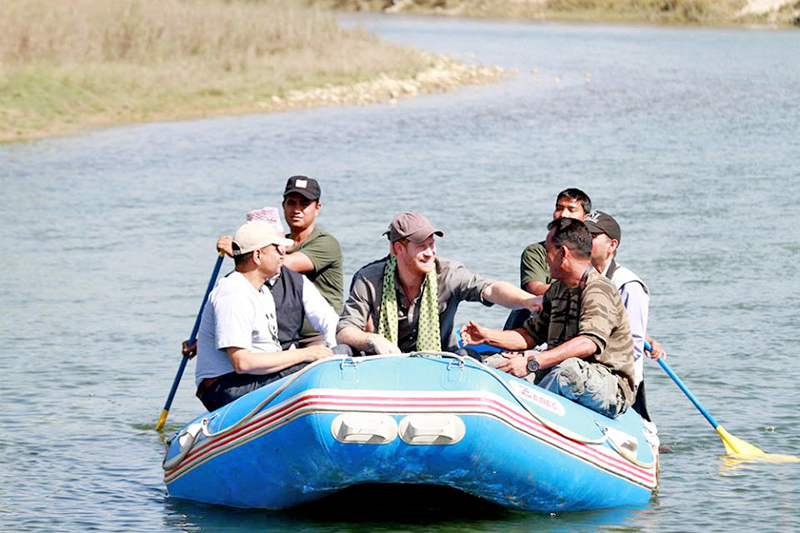 Prince Harry smiles while rafing at the Khauraha River in Bardia National Park on Monday, March 21, 2016. Photo: Damudar Bhandari