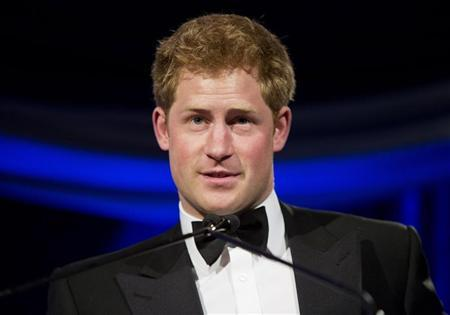 Britain's Prince Harry speaks after receiving the Humanitarian Award from the Atlantic Council during their annual awards dinner in Washington May 7, 2012. REUTERS/Joshua Roberts