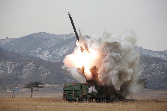 A new multiple launch rocket system is test fired in this undated file photo released by North Korea's Korean Central News Agency (KCNA) in Pyongyang March 4, 2016. REUTERS/KCNA/Files