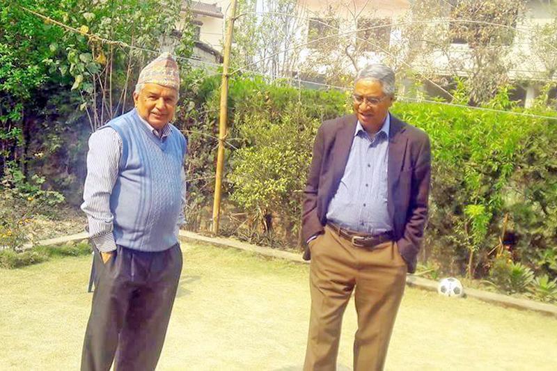 Nepali Congress senior leader Ram Chandra Paudel (left) and party president Sher Bahadur Deuba meet at latter's residence in Bohoratar in Kathmandu on Wednesday, March 23, 2016. Photo: RSS