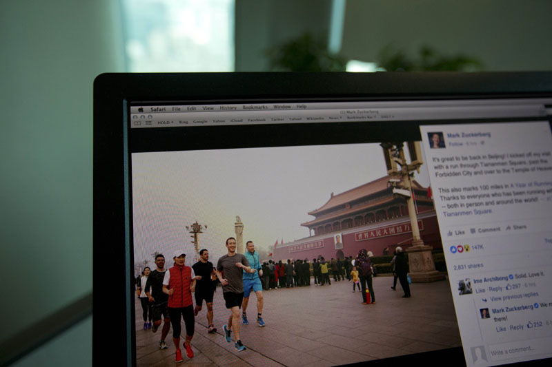 A computer screen displays the social media posting by Mark Zuckerberg on Facebook in Beijing, China, on Friday, March 18, 2016. Photo: AP
