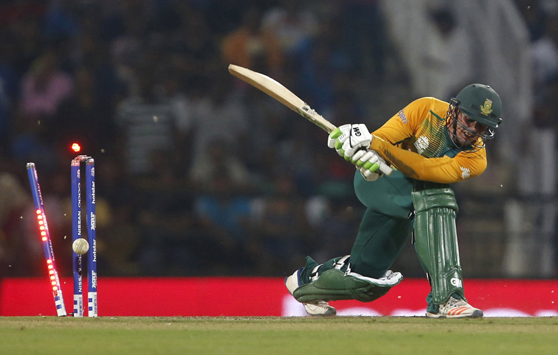 South Africa's Quinton de Kock is bowled during ICC Twenty20 Cricket tournament againt West Indies in Nagpur on Friday, March 25, 2016. Photo: Reuters