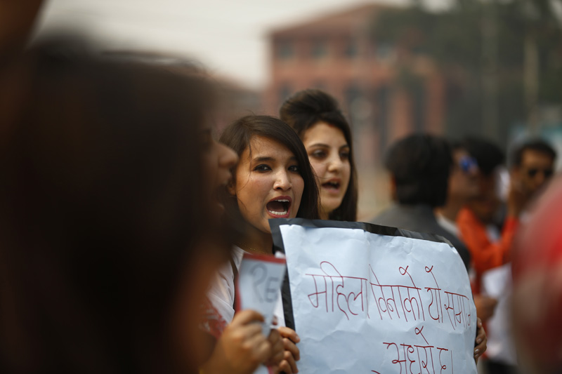 Women hold placards during a demonstration against violence against women organised by Women's Room Reloaded in Maitighar, Kathmandu on Saturday, March 26, 2016. Photo: Skanda Gautam