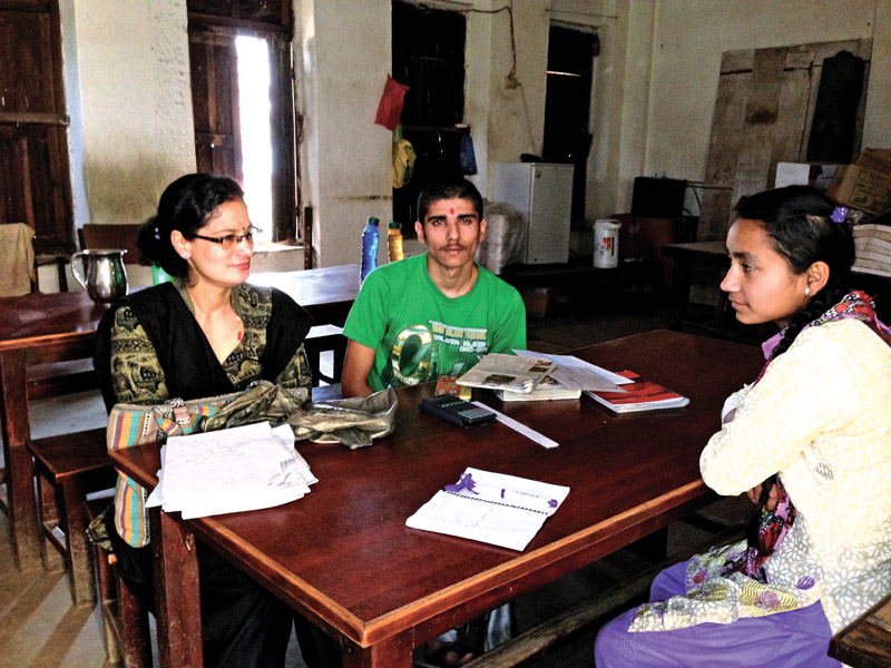 A visually impaired boy Sujan Dhakal preparing for his SLC exams with his teacher Indira Aryal and writer Sarita Sunar. Photo: THT