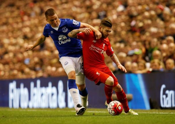 Football Soccer - Liverpool v Everton - Barclays Premier League - Anfield - 20/4/16nLiverpool's Alberto Moreno in action with Everton's James McCarthynReuters / Andrew YatesnLivepic