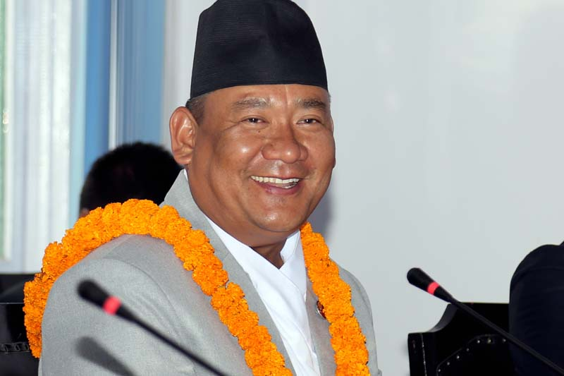 Newly elected Assistant Minister for Federal Affairs and Local Development Resham Bahadur Lama smiles for the camera after being administered to the post in Singha Durbar, on Wednesday, April 27, 2016. Photo: RSS