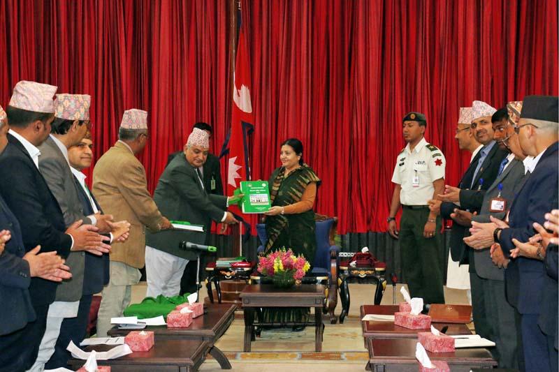 Auditor General Bhanu Prasad Acharya presents the 53rd Annual Report to President Bidya Devi Bhandari at latter's office in Sheetal Niwas, on Monday, April 11, 2016. Photo: RSS