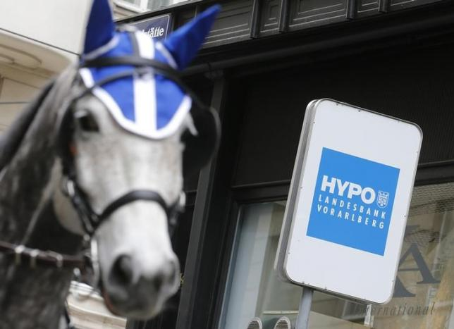A traditional Fiaker horse carriage passes a Hypo Landesbank Vorarlberg brnach office, one of two Austrian lenders mentioned in the massive Panama Papers data leak, in Vienna, Austria, April 7, 2016. REUTERS/Heinz-Peter Bader