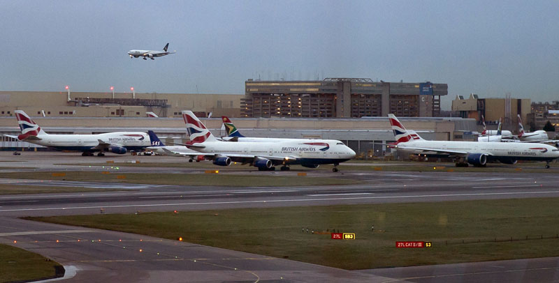 FILE - Aircraft wait on the tarmac at Heathrow Airport in London, on Friday, December 12, 2014. Photo: Vadim Ghirda/AP