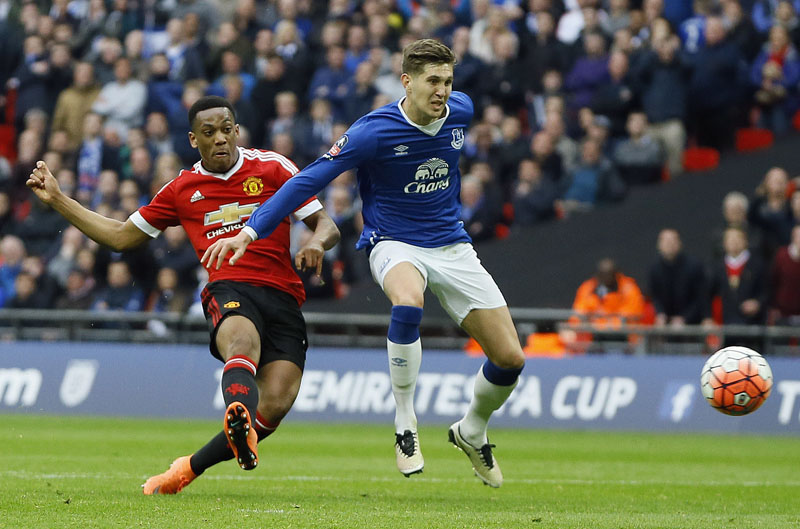 Unitedu2019s Anthony Martial (left) scores the winning goal during the English FA Cup semifinal football match between Everton and Manchester United at Wembley stadium in London, Saturday, April 23, 2016.(AP Photo/Kirsty Wigglesworth)