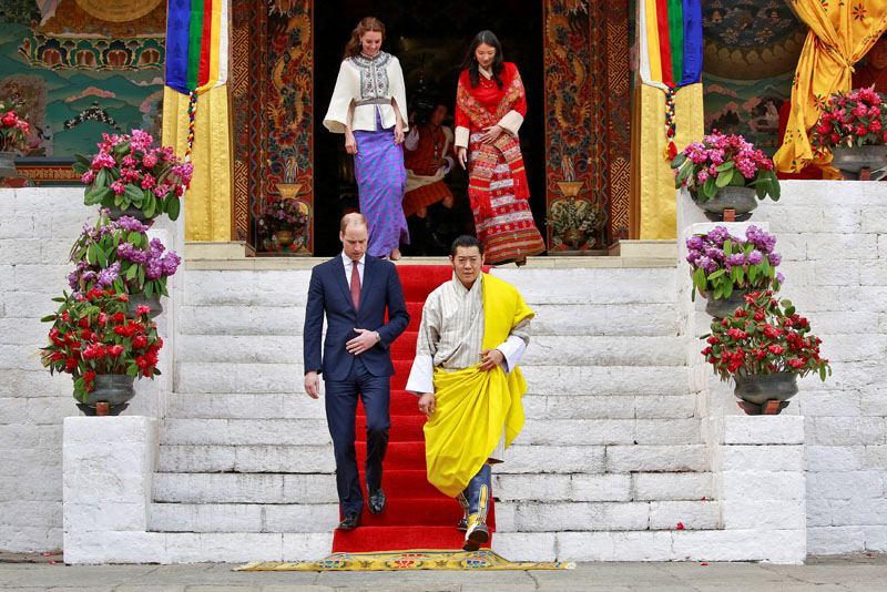 Britain's Prince William, Duke of Cambridge and his wife Catherine, Duchess of Cambridge are shown around the Tashichho Dzong temple by King Jigme Khesar Namgyel Wangchuck and his wife Jetsun Pema in Thimphu, Bhutan, on Thursday, April 14, 2016. Photo: Cathal McNaughton/Reuters