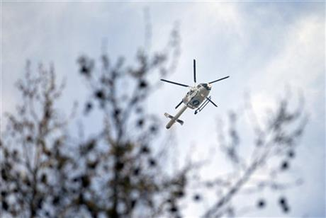 A police helicopter flies above the federal court building in Brussels on Thursday, April 14, 2016. Suspects from the Brussels and Paris attacks appeared in court Thursday for a court hearing to decide whether or not to extend their detention. AP