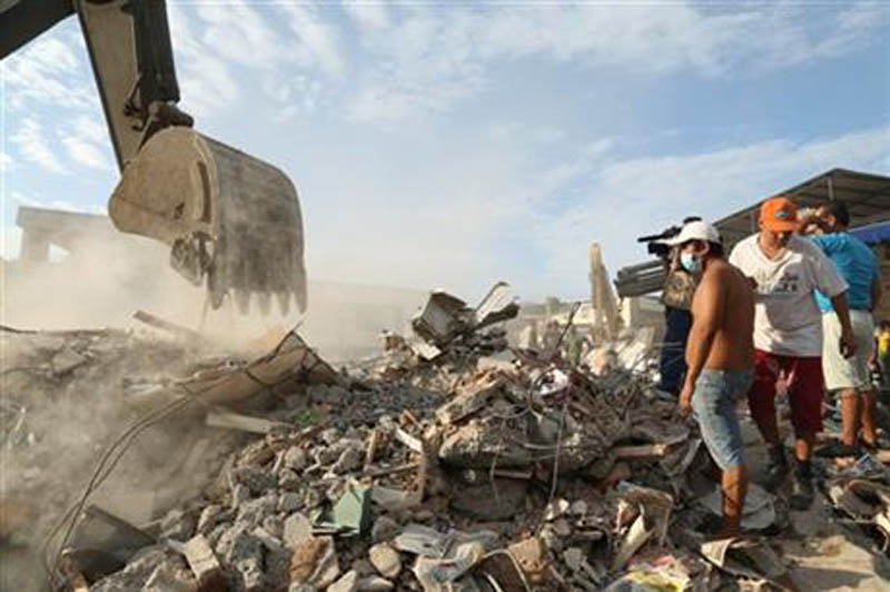 A bulldozer moves rubble after an earthquake in Portoviejo, Ecuador, Sunday, April 17, 2016. Rescuers pulled survivors from the rubble Sunday after the strongest earthquake to hit Ecuador in decades flattened buildings and buckled highways along its Pacific coast on Saturday. Photo: AP