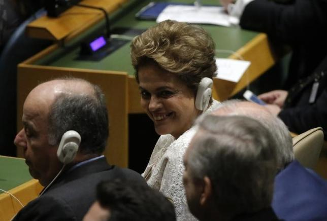 Brazilian President Dilma Rousseff talks with fellow delegates during the signing ceremony on climate change held at the United Nations Headquarters in Manhattan, New York, U.S., April 22, 2016. REUTERS/Carlo Allegri