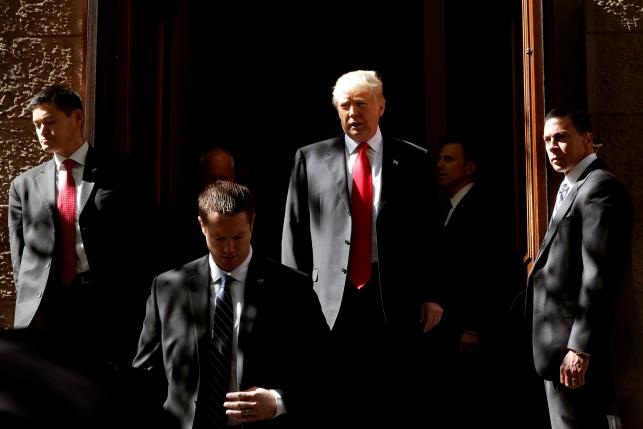 Republican presidential candidate Donald Trump exits a polling station after voting for the New York primary election in Manhattan, New York City, April 19, 2016. REUTERS/Andrew Kelly