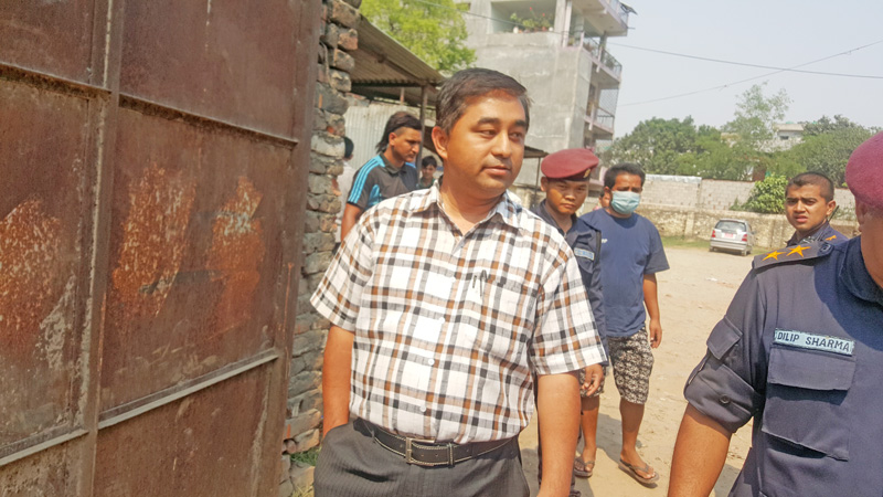 Dr. Gyan Bahadur Shrestha, radiologist at BP Koirala Memorial Cancer Hospital, is arrested by police for playing truant and working at a private clinic during office hours, in Chitwan, on Monday, April 25, 2016. Photo: Tilak Rimal