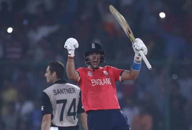 England's Joe Root (R) celebrates past New Zealand's Mitchell Santner after winning their match.  REUTERS