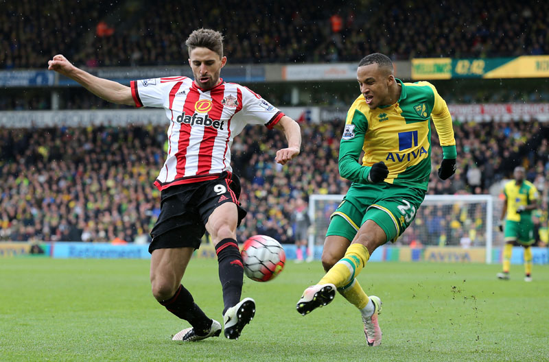 Sunderland's Fabio Borini (left) and Norwich City's Martin Olsson in action during their English Premier League football match at Carrow Road, Norwich, England, on Saturday April 16, 2016. Photo: Chris Radburn / PA via AP