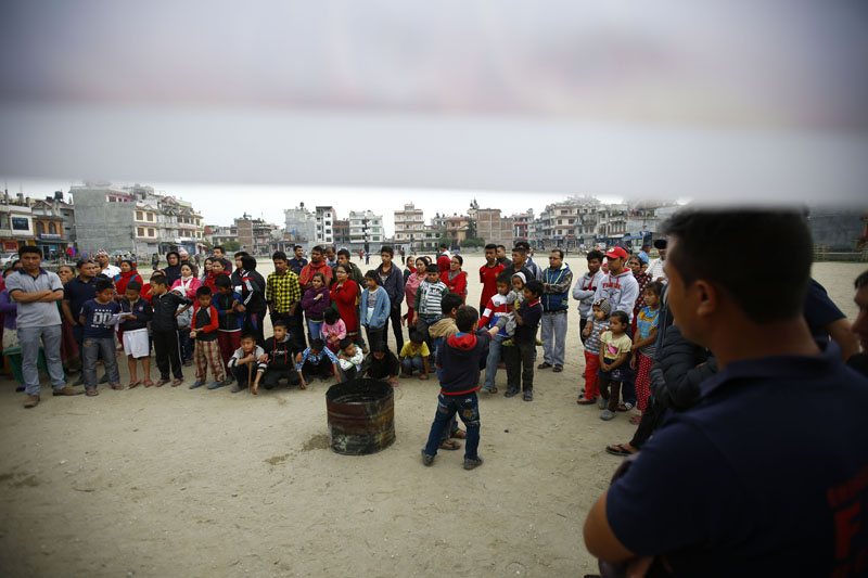 Locals gather at the public awareness programme organised by Nepal Rescue and Firefighting Department from TIA at Pepsi Cola Football Ground in Purano Sinanamangal, Kathmandu. Photo: Skanda Gautam/THT