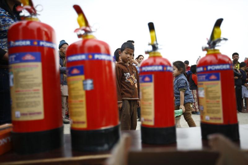 Fire extinguishing cansters in display. Photo: Skanda Gautam/THT