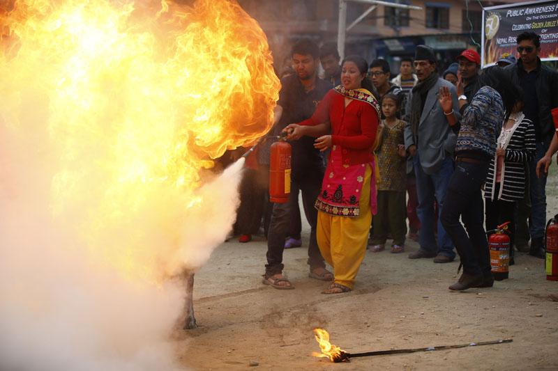 A woman experiments extinguishing flame. Photo: Skanda Gautam/THT