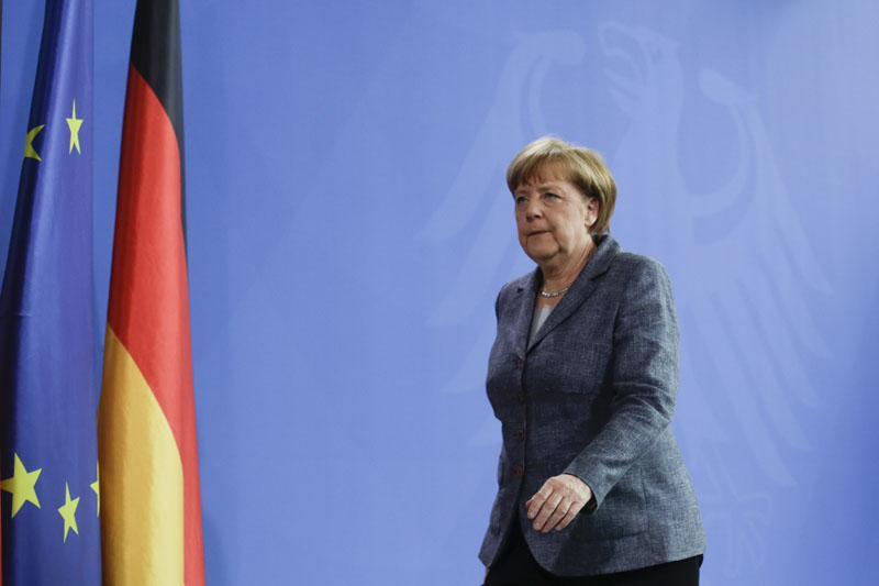 German Chancellor Angela Merkel leaves after a statement at the chancellery in Berlin, on Friday, April 15, 2016. Photo: Markus Schreiber/AP