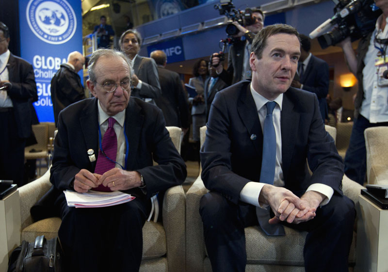 Italian Finance Minister Pier Carlo Padoan (left) sits with Britain's Chancellor of the Exchequer George Osborne during the International Monetary and Financial Committee (IMFC) conference at the World Bank/IMF Spring Meetings at IMF headquarters in Washington, on Saturday, April 16, 2016. Photo: Jose Luis Magana/AP