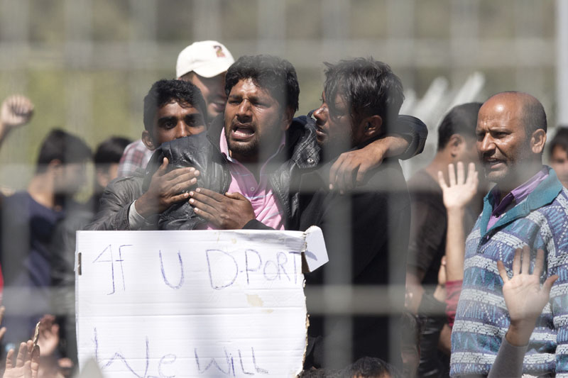 Refugees and  migrants most of them from Pakistan protest against EU- Turkey deal about migration inside the entrance of Moria camp in the Greek island of Lesbos on Tuesday, April 5, 2016. Photo: AP