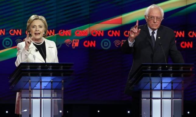 Democratic U.S. presidential candidates Hillary Clinton (L) and Bernie Sanders both gesture during a Democratic debate hosted by CNN and New York One at the Brooklyn Navy Yard in New York April 14, 2016. REUTERS/Lucas Jackson