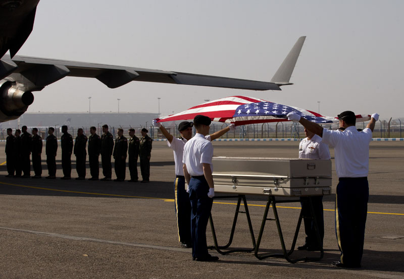 US military members pay final respects to what they believe may be the remains of one to two crew members from a B-24 bomber that crashed during World War II at a ceremony at the Palam airport, in New Delhi, India, on Wednesday, April 13, 2016. Photo: AP