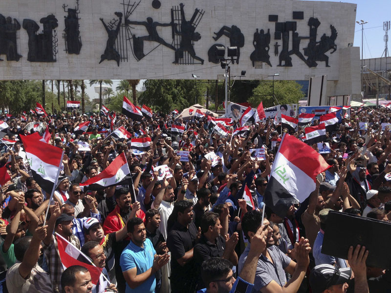 Followers of Shiite cleric Muqtada al-Sadr gather chant slogans during a sit-in at Tahrir Square, Baghdad, Iraq, on Monday, April 18, 2016. Photo: Ziad Hammad/AP
