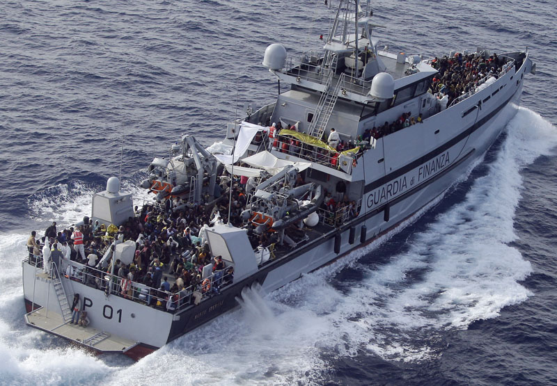 FILE - Rescued migrants are seen aboard MP01 ship of the Italian border police in the Mediterranean Sea, heading to the Island of Lampedusa, southern Italy, on Thursday, May 14, 2015.  Photo: Antonio Calanni/AP