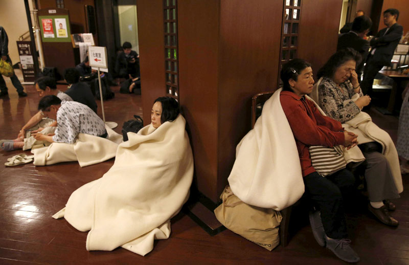 Hotel guests gather at the lobby after another earthquake hit the area in Kumamoto, southern Japan, on Friday, April 16, 2016. Photo: Kyodo/Reuters