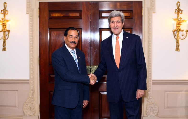 Deputy Prime Minister and Minister for Foreign Affairs Kamal Thapa shakes hands with US Secretary of State John Kerry at the US State Department on Tuesday, April 26, 2016. Photo: Embassy of Nepal