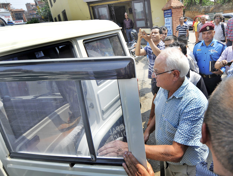 File- Senior journalist Kanak Mani Dixit being detained by Commission for the Investigation of Abuse of Authority from his residence in Patan Dhoka, Lalitpur, on Friday, April 22, 2016. Photo: THT