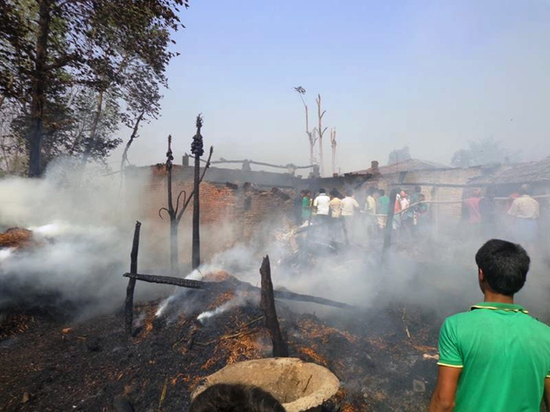 Locals try to contain the fire in Harshaha of Rautahat district on Saturday, April 9, 2016. Photo: Prabhat Kumar Jha