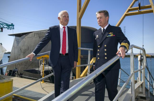 Australian Prime Minister Malcolm Turnbull (L) disembarks an Australian Navy submarine with Australian Navy officer Vice Admiral Timothy Barrett in Adelaide, Australia, April 26, 2016.    AAP/Ben Macmahon/via REUTERS