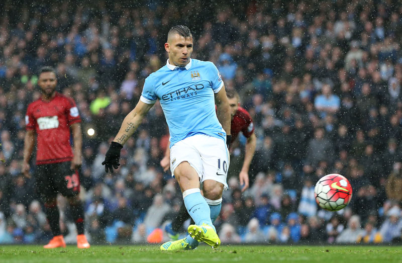 Manchester City's Sergio Aguero scores his side's first goal from the penalty spot against West Bromwich Albion's James Chester in action during the English Premier League football match at the Etihad Stadium, Manchester, England, on Saturday April 9, 2016. Photo: Martin Rickett/PA via AP