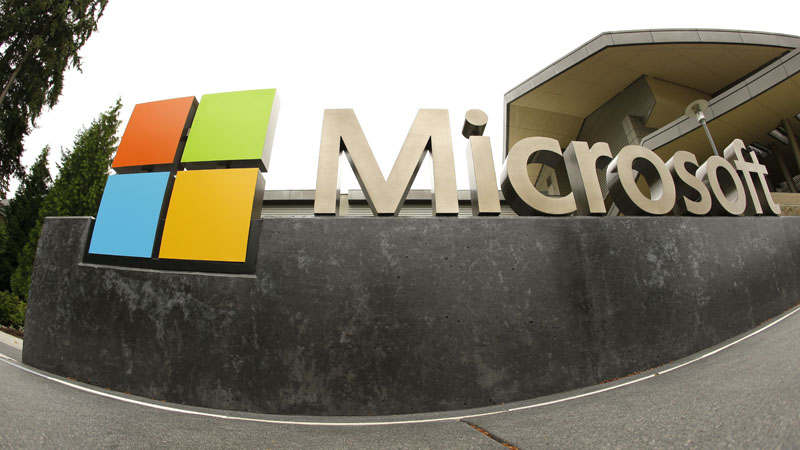 FILE - The Microsoft Corporation logo outside the Microsoft Visitor Center in Redmond, Washington, on July 3, 2014. Photo: Ted S Warren/AP