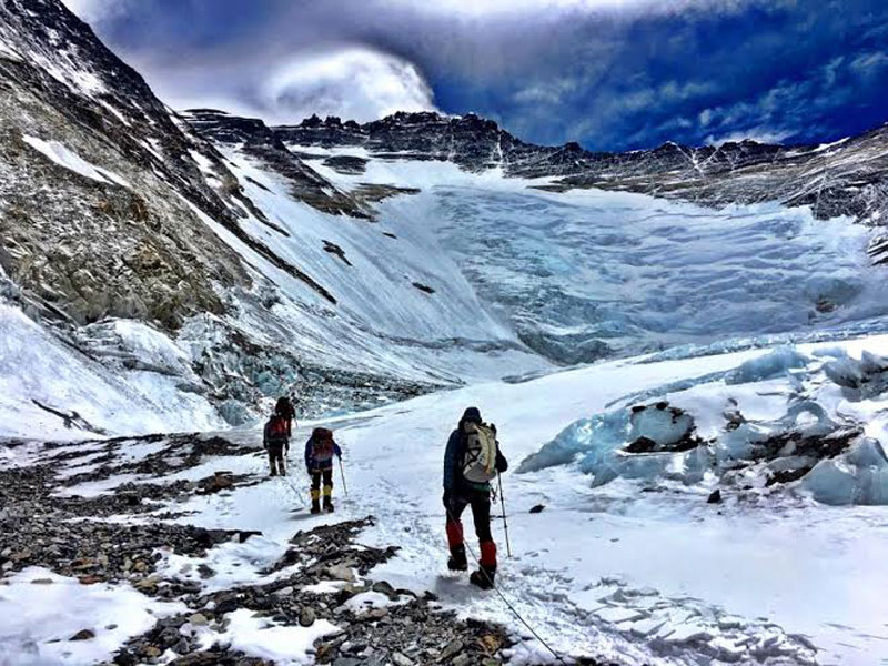 Climbers heading to the Lhotse Face from Camp II on Mt Everest. Photo Courtesy: Garrett Madison