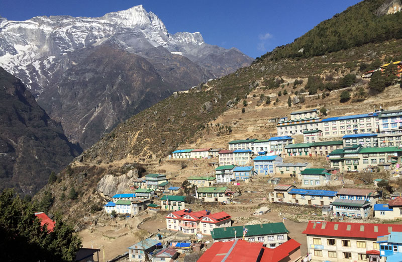 The village of Namche Bazaar, one of the main communities in the Khumbu region surrounding Everest in Nepal, on April 5, 2016. Trekkers often spend an extra day in Namche Bazaar, at an altitude of 3,440 metres ((11,287 feet), to acclimatise and stock up on supplies. A trek to Everest Base Camp along mountain paths that hug deep gorges offers renewal and a test of mental and physical limits. Along the way there are sore knees and altitude sickness, but the spectacular landscapes, friendly villagers and moments of tranquility make the journey an unforgettable experience. Photo: Karin Laub/AP