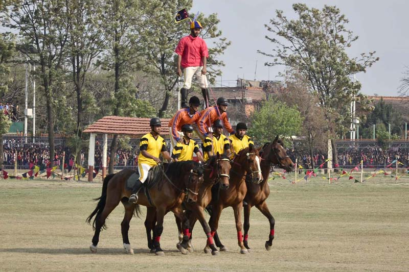 Nepal Army soldiers demonstrate a stunt during the 'Ghode Jatra Festival 2072' at the Army Pavilion