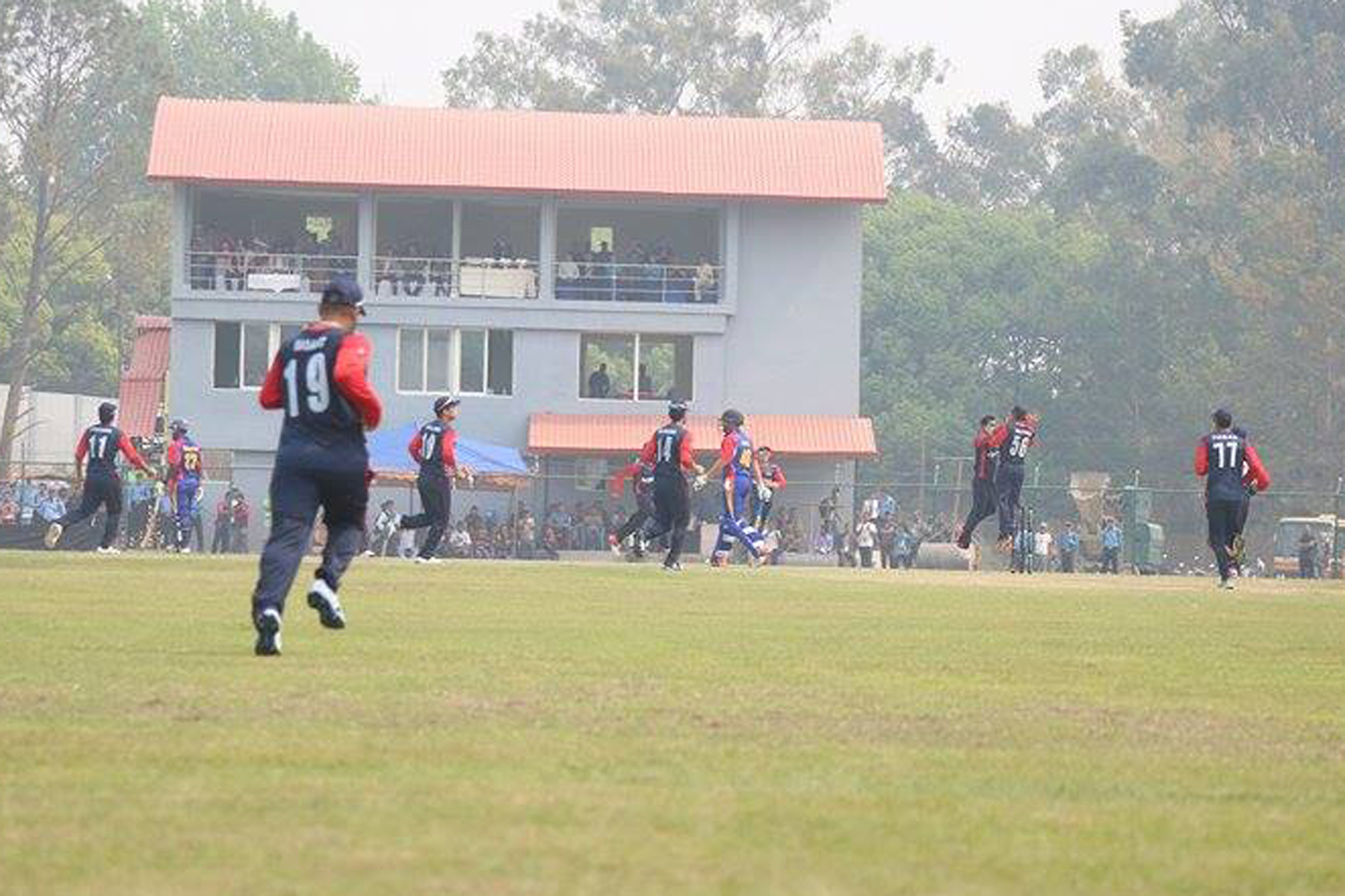 Nepal players celebrate after taking a wicket against Namibia during the match of the ICC World Cricket League Championship round-three matches held at the Tribhuvan University Cricket Stadium in Kirtipur on Saturday, April 16, 2016. Photo: RSS